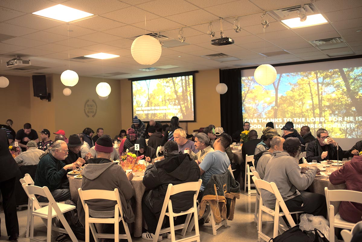 Guests enjoying Thanksgiving at New York City Rescue Mission