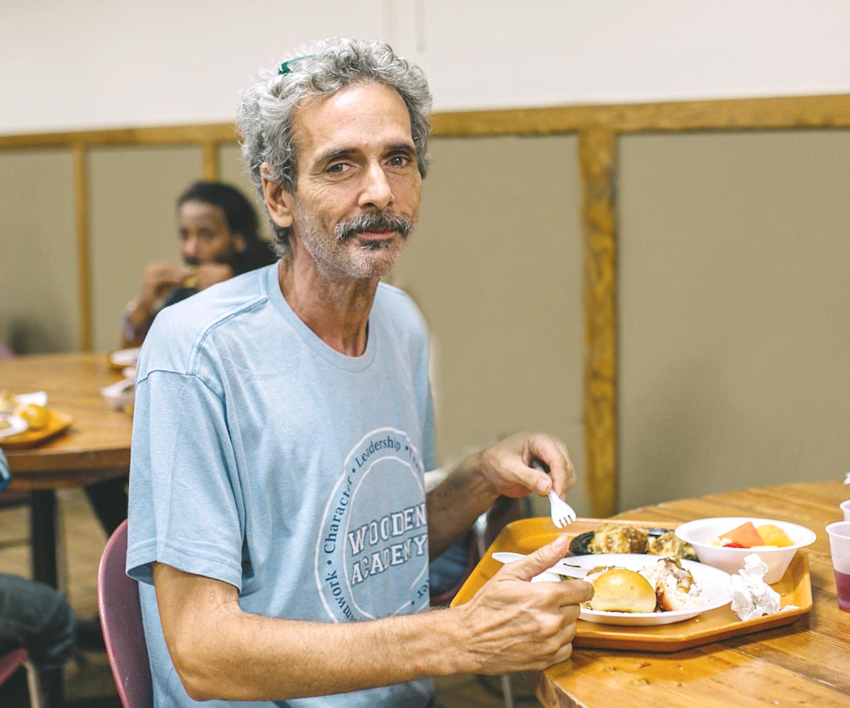 Guest eats a meal at The Bowery Mission
