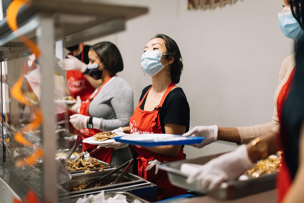 Volunteer serving meal