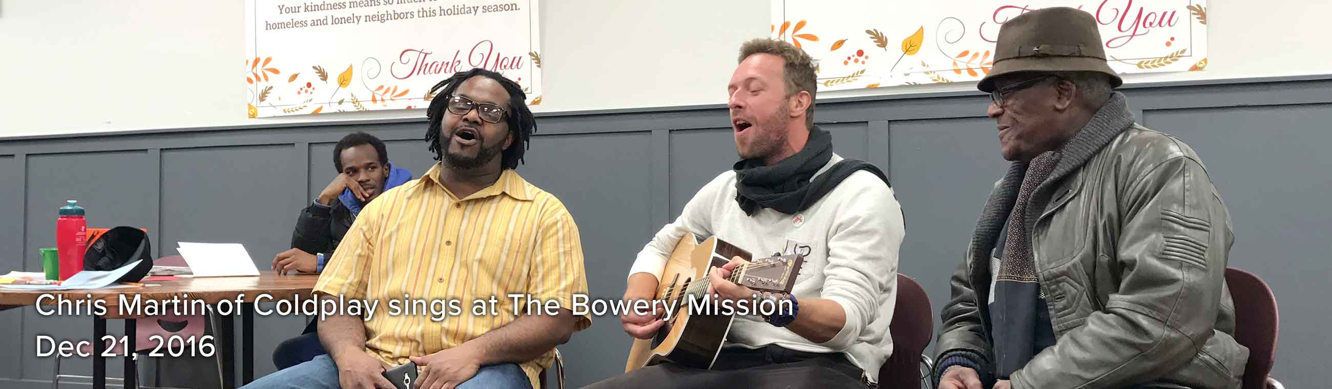 Chris Martin singing at The Bowery Mission