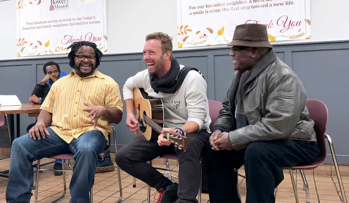Chris Martin from Coldplay sings at The Bowery Mission