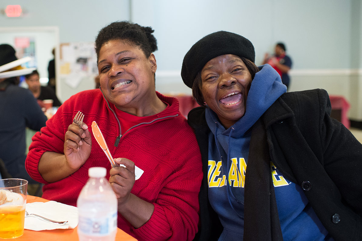 Women enjoying Thanksgiving meal at Goodwill Rescue Mission